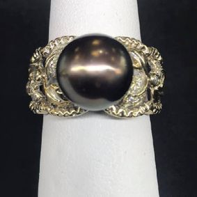 view of a ring with pearl