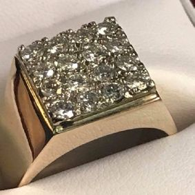 diamond studded ring in its case